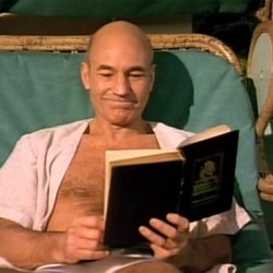 Picard relaxing with a book on Risa